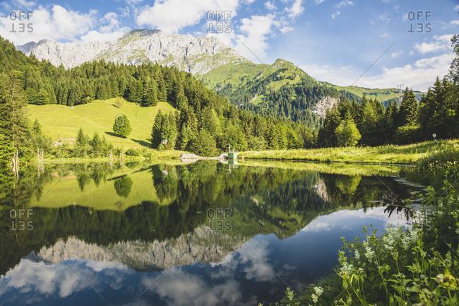 Austria- Carinthia- Scenic view of shiny lake in Carnic Alps