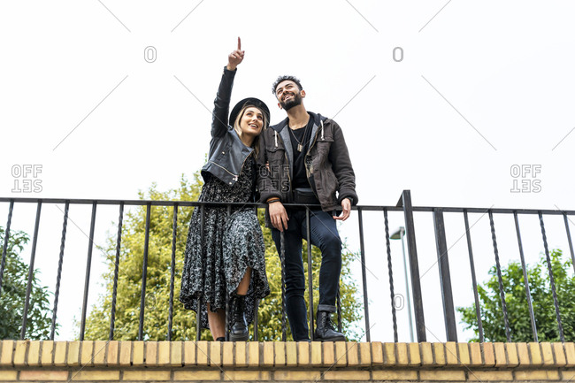Young couple watching something