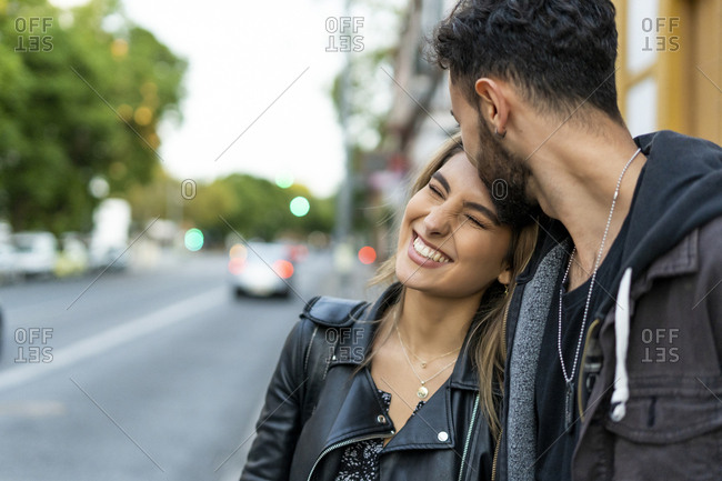 Portrait of happy young woman with her boyfriend