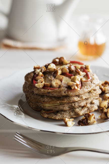 Plate of gluten free buckwheat pancakes with banana- apple and nuts
