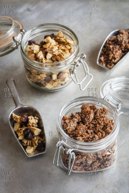 Jars and serving scoops of two homemade granola