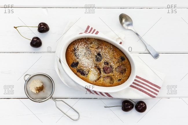 Bowl of gluten free homemade clafoutis with cherries- peaches and almonds