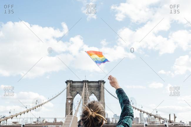 Woman waving LGBT flag in NYC- USA