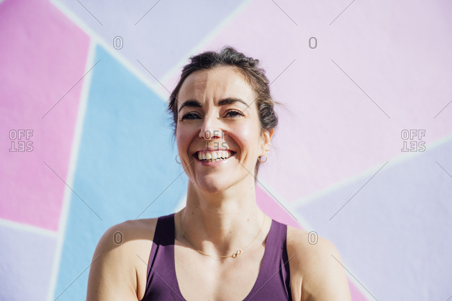 Portrait of smiling sportswoman looking at camera