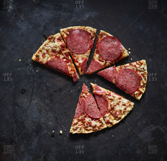 Slices of salami pizza