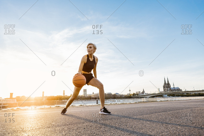 Blonde woman playing basketball in Cologne- Germany
