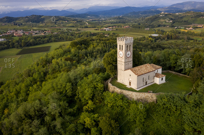 Italy- Friuli Venezia Giulia- Brazzano- Aerial view of secluded church on top of forested hill