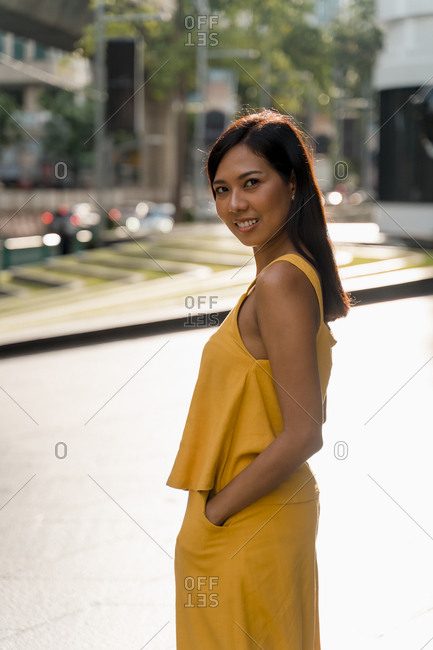 Portrait of fashionable woman dressed in yellow