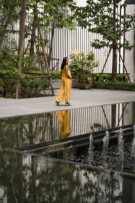 Fashionable woman dressed in yellow strolling in the city