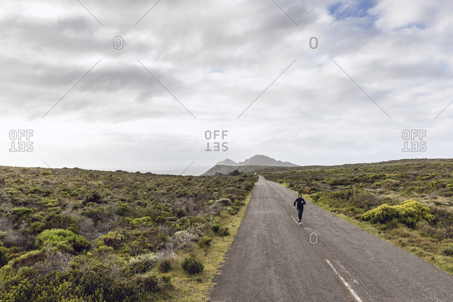 Man jogging on country road- Cape Point- Western Cape- South Africa