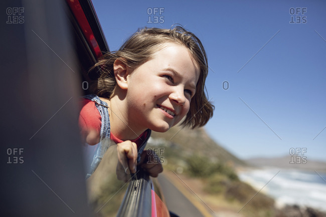 Portrait of smiling girl looking out of car window- Cape Town- Western Cape- South Africa
