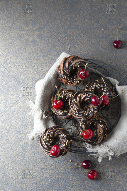 Basket of German minigugelhupf cakes with chocolate- brittle and cherries
