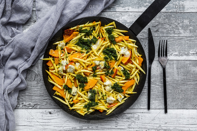 Pan of German scoundrel with pumpkin- kale and Gorgonzola cheese