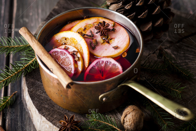 Mulled wine with oranges and cinnamon in a saucepan