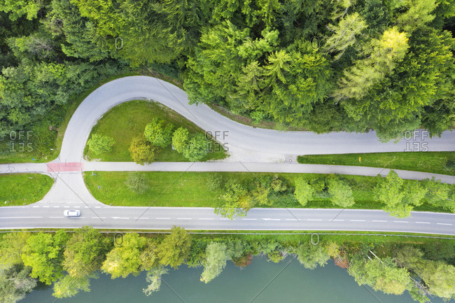 Germany- Bavaria- Eurasburg- Aerial view of edge of green spruce forest and junction of countryside highway
