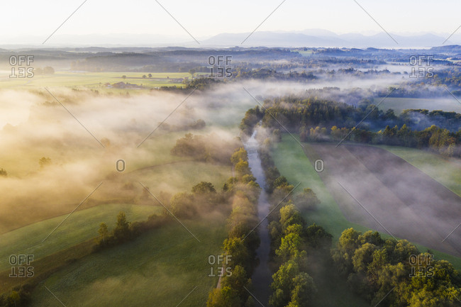 Germany- Bavaria- Geretsried- Aerial view of Loisach river canal at foggy dawn
