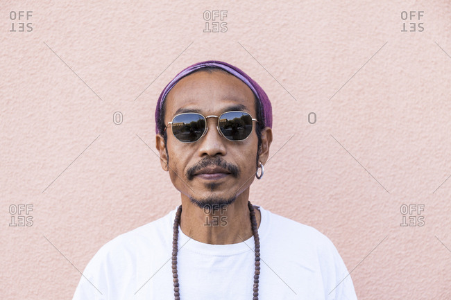 Portrait of mature man with headscarf and sunglasses