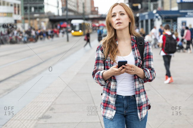 Woman with smartphone in the city- Berlin- Germany