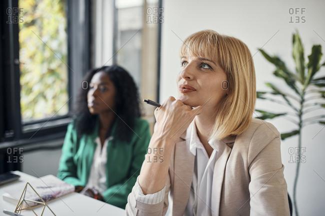 Businesswomen attending a workshop in conference room