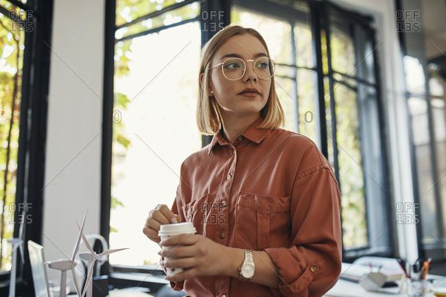 Businesswoman having a coffee break in office