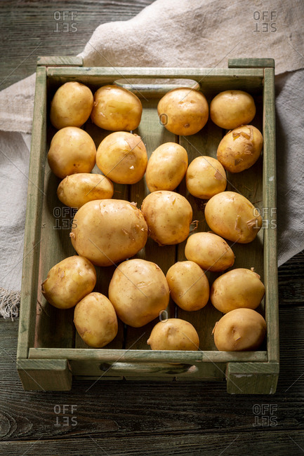 Gold potatoes in a wooden crate