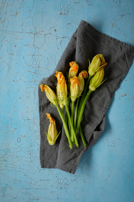 Zucchini flowers on a linen cloth