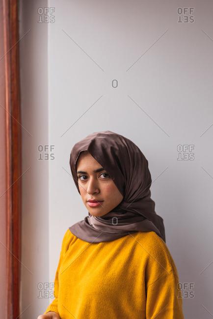 Muslim girl wearing hijab and a yellow sweater