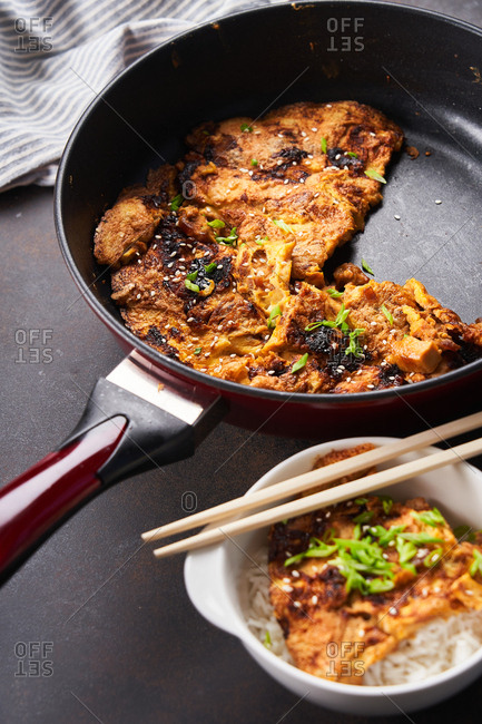 Egg foo young dish being prepared in a skillet