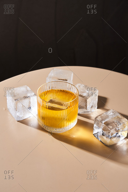Cocktail with cube shaped ice cubes