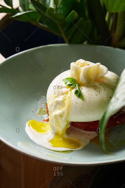Gourmet poached egg dish with drizzled oil