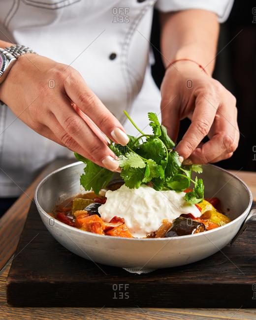 Chef preparing gourmet dish in a frying pan