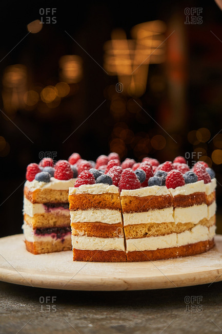 Delicious layered cake with berries on top