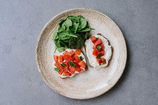 Vegan bruschetta with hummus and tomato