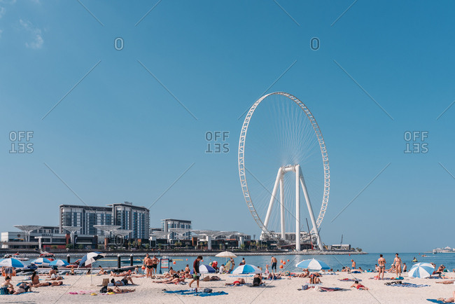 Dubai, United Arab Emirates - November 16, 2019: Large Farris wheel on beach on the coast of Dubai