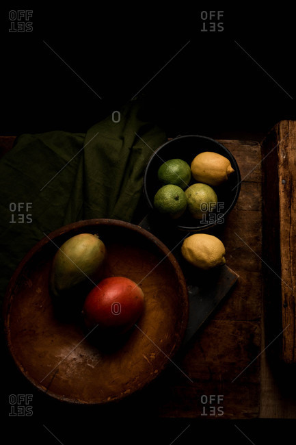 Bowls of fruit on wooden surface