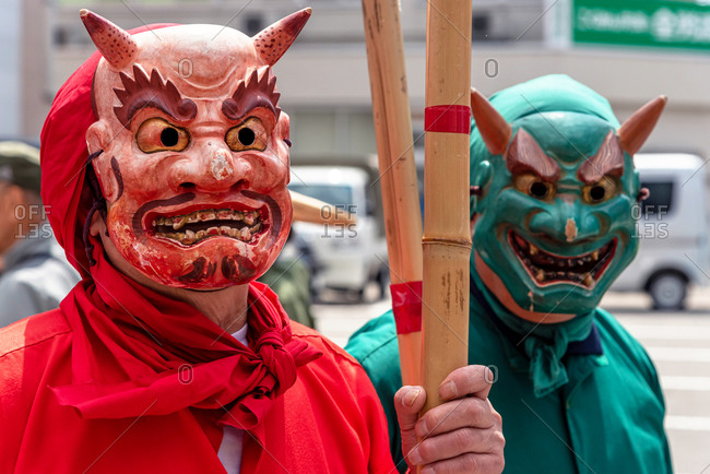 April 15, 2019: Two man wearing traditional demon masks during annual Takayama festival. Takayama, Japan