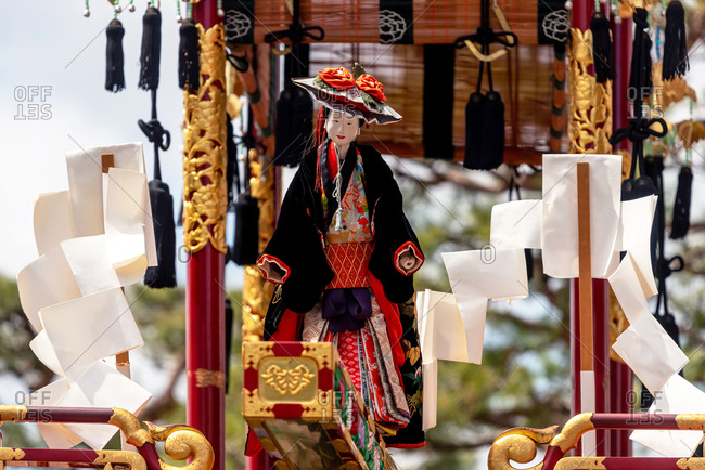 April 15, 2019: Mechanical marionette on a ornate traditional wooden float during the Takayama Spring Festival. Takayama, Japan