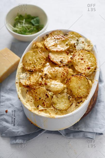 Gratin dauphinoise with potatoes, cauliflower, cream and cheese
