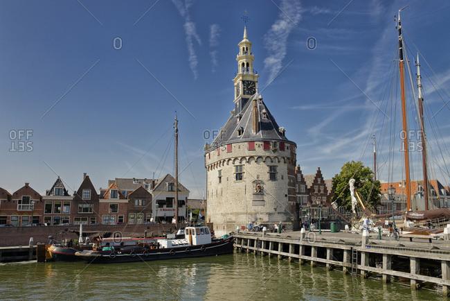 August 23, 2016: Ships in the harbor with the main tower Hofdtoren in Hoorn, Noord Holland, Ijsselmeer, the Netherlands