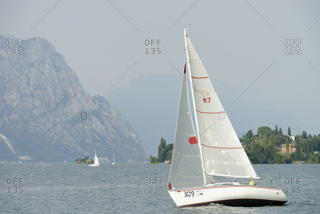 September 4, 2016: Sailboats with Cassone, Lake Garda, province Verona, Veneto, Italy