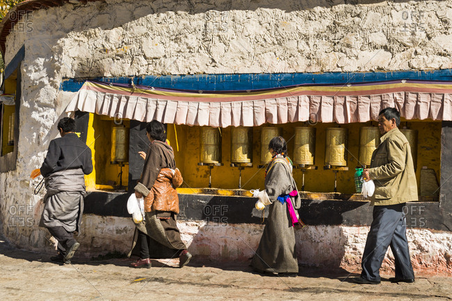 October 1, 2016: Tibet, Drepung Monastery, believers, prayer mills