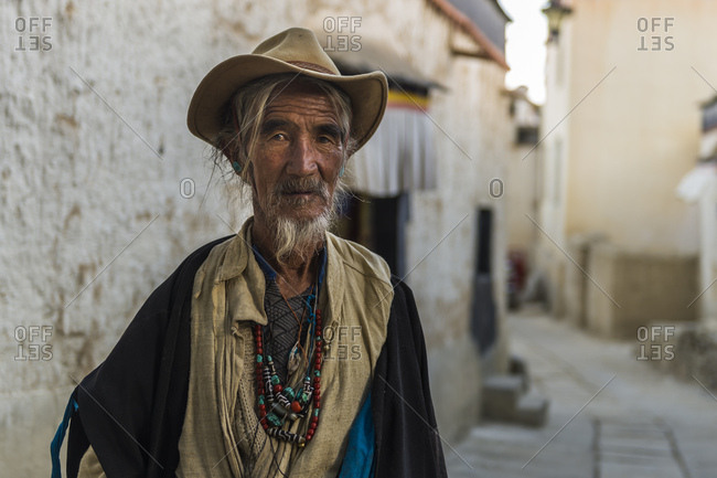 October 6, 2016: Tibet, Shigatse, Old Town, man with hat, portrait