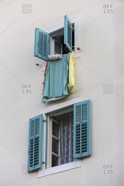 Bed linen is aired on the window sill