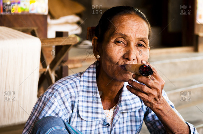 January 19, 2013: old woman with the smoking in a village in Altbagan