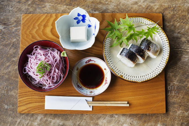 High angle close up of Sushi, Tofu, Noodles and Soy Sauce on a table in Japanese restaurant.