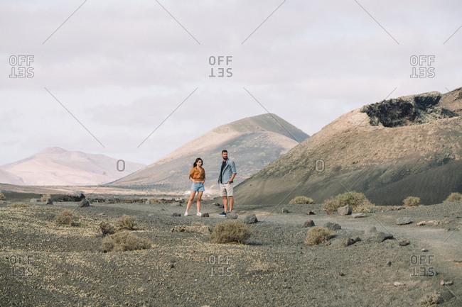 Couple posing outside the Volcano Cuervo in Lanzarote, Timanfaya.