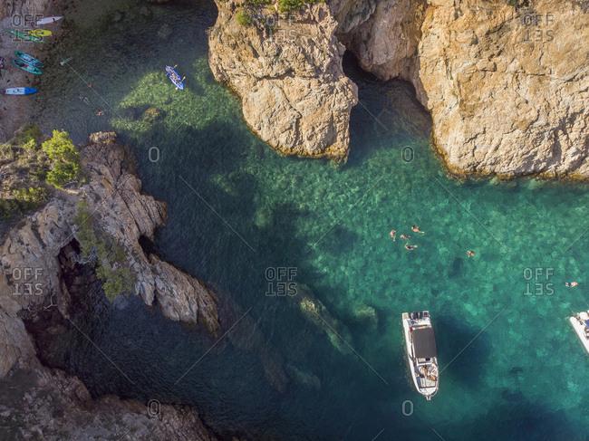 Aerial view of a busy Mediterranean cove in Costa Brava, Spain.