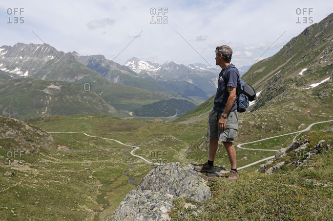 A hiker enjoying the views in the Swiss Alps.