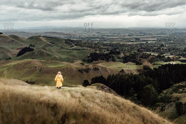 Tween girl looking at scenic view in New Zealand