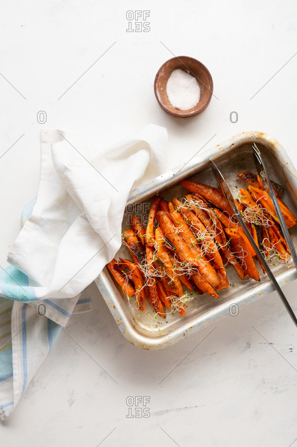 Overhead view of oven baked carrots in baking pan